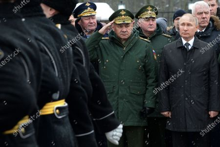 Russian President Vladimir Putin (R) and Defence Minister Sergey Shoygu (C) take part in a wreath-laying ceremony to the monument to paratroopers of the 6th airborne troops company of the 76 Pskov Airborne troops division, who perished in an anti-terrorist operation in Chechnya in 2000, in Pskov, Russia, 01 March 2020.