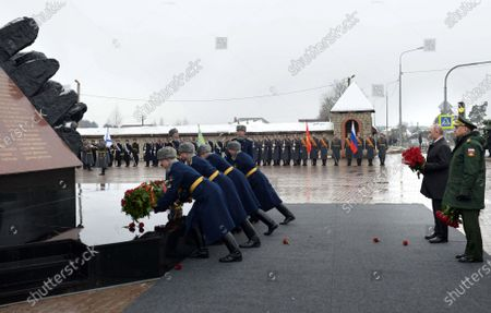 Russian President Vladimir Putin (2-R) and Defence Minister Sergey Shoygu (R) take part in a wreath-laying ceremony to the monument to paratroopers of the 6th airborne troops company of the 76 Pskov Airborne troops division, who perished in an anti-terrorist operation in Chechnya in 2000, in Pskov, Russia, 01 March 2020.