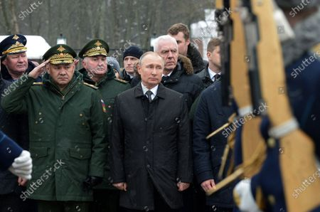 Russian President Vladimir Putin (C) and Defence Minister Sergey Shoygu (2 L) take part in a wreath-laying ceremony to the monument to paratroopers of the 6th airborne troops company of the 76 Pskov Airborne troops division, who perished in an anti-terrorist operation in Chechnya in 2000, in Pskov, Russia, 01 March 2020.