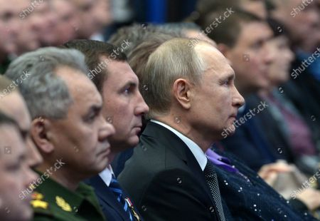 Russian President Vladimir Putin (C) and Defence Minister Sergey Shoygu (L) attend a concert to commemorate the paratroopers of the 6th airborne troops company of the 76 Pskov Airborne troops division, who perished in an anti-terrorist operation in Chechnya in 2000, in Pskov, Russia, 01 March 2020.