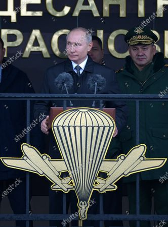 Russian President Vladimir Putin (C) and Defence Minister Sergey Shoygu (R) visit the base of 76th Airborne Division in Pskov, Russia, 01 March 2020.