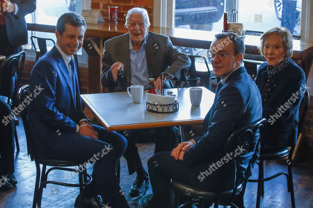 Democratic presidential candidate former South Bend, Ind., Mayor Pete Buttigieg, left, and his husband Chasten Buttigieg, second from the right, meet with former President Jimmy Carter, center, and former first lady Rosalynn Carter, at Buffalo Cafe in Plains, Ga