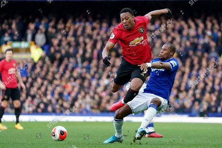 Everton's Djibril Sidibe, right, tackles Manchester United's Anthony Martial during the English Premier League soccer match between Everton and Manchester United at Goodison Park in Liverpool, England