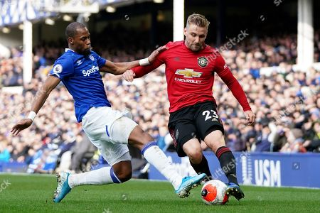 Everton's Djibril Sidibe vies for the ball with Manchester United's Luke Shaw, right, during the English Premier League soccer match between Everton and Manchester United at Goodison Park in Liverpool, England