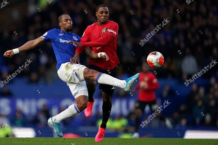 Everton's Djibril Sidibe, left, clears the ball away from Manchester United's Odion Ighalo during the English Premier League soccer match between Everton and Manchester United at Goodison Park in Liverpool, England