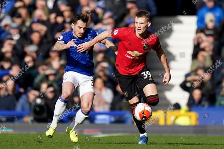 Everton's Leighton Baines vies for the ball with Manchester United's Scott McTominay, right, during the English Premier League soccer match between Everton and Manchester United at Goodison Park in Liverpool, England