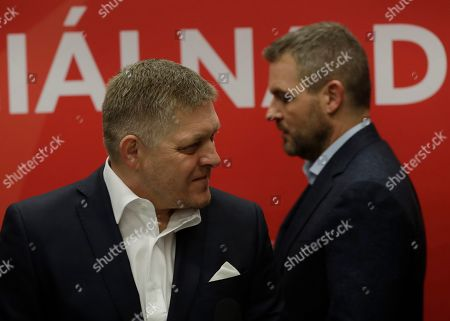 Leader of the Smer-Social Democracy party Robert Fico, left, and Slovakia's Prime Minister Peter Pellegrini arrive for a press conference day after the Slovakia's general election in Bratislava,. According to nearly complete results released by the Statistics Office early Sunday the senior ruling leftist Smer-Social Democracy party led by former populist Prime Minister Robert Fico was in second with 18.3% or 38 seats