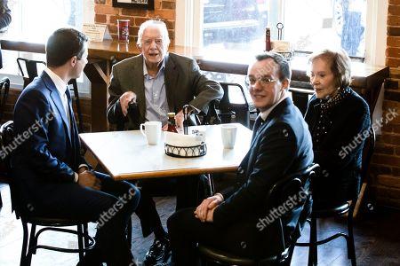 Pete Buttigieg, Jimmy Carter, Chasten Buttigieg, Rosalynn Carter. Democratic presidential candidate former South Bend, Ind., Mayor Pete Buttigieg, left, and his husband Chasten Buttigieg, second from the right, meet with former President Jimmy Carter, center, and former first lady Rosalynn Carter, at the Buffalo Cafe in Plains, Ga