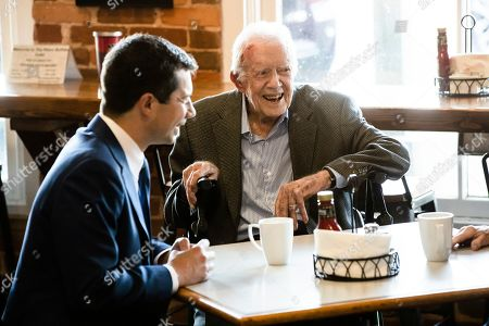 Pete Buttigieg, Jimmy Carter. Democratic presidential candidate and former South Bend, Ind., Mayor Pete Buttigieg, left, meets with former President Jimmy Carter, center, at the Buffalo Cafe in Plains, Ga
