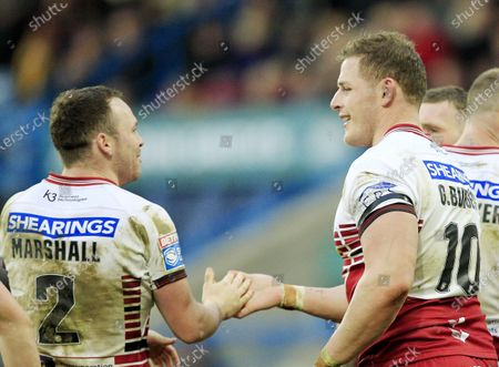 Wigan's last try scorer George Burgess congratulated by Liam Marshall