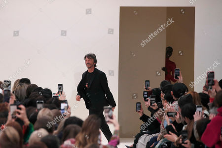Designer Pierpaolo Piccioli accepts applause at the conclusion of the Valentino fashion collection during Women's fashion week Fall/Winter 2020/21 presented in Paris