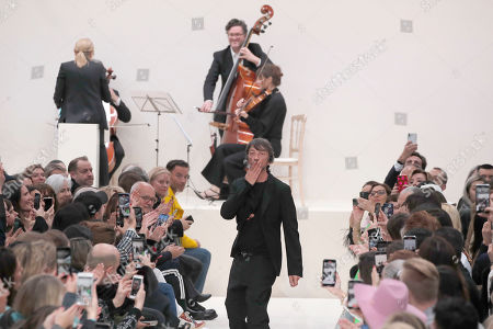 Stock Picture of Designer Pierpaolo Piccioli accepts applause at the conclusion of the Valentino fashion collection during Women's fashion week Fall/Winter 2020/21 presented in Paris