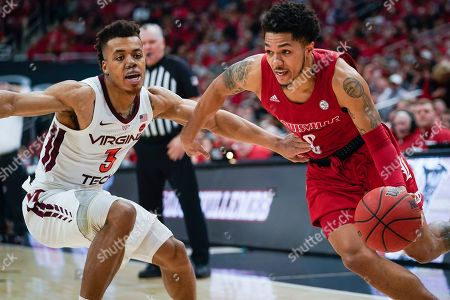 Louisville guard Lamarr Kimble (0) dribbles around Virginia Tech guard Wabissa Bede (3) during the second half of an NCAA college basketball game, in Louisville, Ky