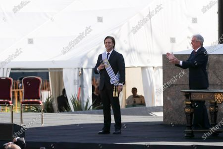 Outgoing president of Uruguay, Tabare Vazquez (R), delivers the presidential band to Luis Lacalle Pou (L), in Montevideo, Uruguay, 01 March 2020 . Lacalle Pou swore the position before the General Assembly for the period 2020-2025.