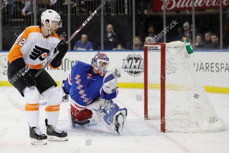 Michael Raffl, Henrik Lundqvist. Philadelphia Flyers' Michael Raffl, left, scores past New York Rangers goaltender Henrik Lundqvist during the first period of the NHL hockey game, in New York