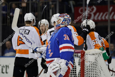 New York Rangers goaltender Henrik Lundqvist reacts after being scored on by the Philadelphia Flyers during the first period of the NHL hockey game, in New York