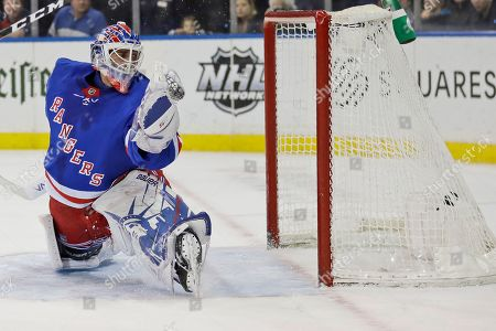 Stock Image of New York Rangers goaltender Henrik Lundqvist watches as the puck gets past him during the first period of the NHL hockey game against the Philadelphia Flyers, in New York