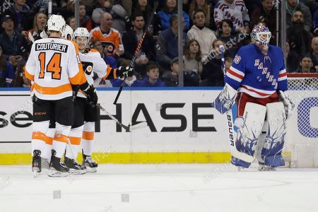 Stock Photo of New York Rangers goaltender Henrik Lundqvist, right, reacts as the Philadelphia Flyers celebrates a goal by Travis Konecny, second from right, during the second period of the NHL hockey game, in New York