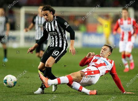 Partizan's Lazar Markovic (L) in action against Red Star's Milan Rodic (R) during the Serbian SuperLiga soccer derby match between Red Star and Partizan in Belgrade, Serbia, 01 March 2020.