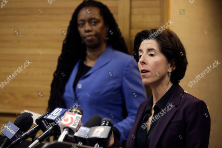 Stock Picture of Rhode Island Gov. Gina Raimondo, right, and R.I. Director of Health Nicole Alexander-Scott, behind left, face reporters during a news conference, in Providence, R.I. The two took questions on what officials described as the state's first presumptive positive case of coronavirus. Officials said the person is in their 40s and had traveled to Italy in February of 2020