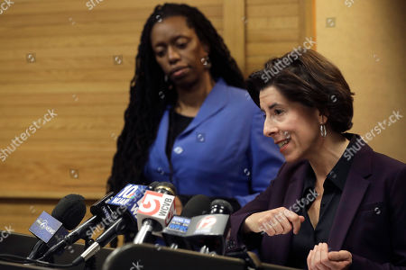 Rhode Island Gov. Gina Raimondo, front right, and R.I. Director of Health Nicole Alexander-Scott, behind left, face reporters during a news conference, in Providence, R.I. The two took questions on what officials described as the state's first presumptive positive case of coronavirus. Officials said the person is in their 40s and had traveled to Italy in February of 2020