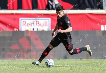 New York Red Bulls forward Brian White (42) brings the ball upfield during an MSL game between FC Cincinnati and the New York Red Bulls at Red Bull Arena in Harrison, NJ