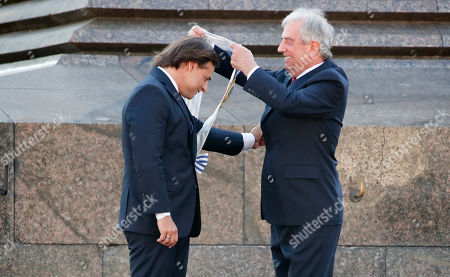 Uruguay's new President Luis Lacalle Pou receives the presidential sash from outgoing president Tabare Vazquez in Montevideo, Uruguay
