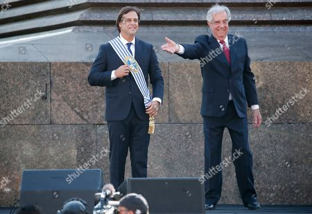 Uruguay's new President Luis Lacalle smiles after receiving the presidential sash from outgoing president Tabare Vazquez in Montevideo, Uruguay