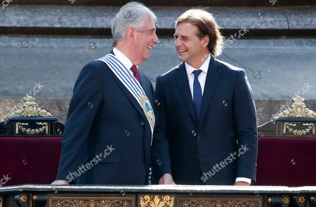 Uruguay's new President Luis Lacalle Pou smiles at outgoing president Tabare Vazquez before receiving the presidential sash in Montevideo, Uruguay