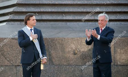 Stock Picture of Uruguay's new President Luis Lacalle gestures after receiving the presidential sash from outgoing president Tabare Vazquez in Montevideo, Uruguay, . Lacalle Pou inaugurated as Uruguay's youngest ever president on Sunday ending 15 years of left leaning administrations