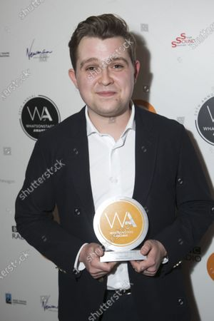 Jack Loxton accepts the award for Best Supporting Actor in a Musical