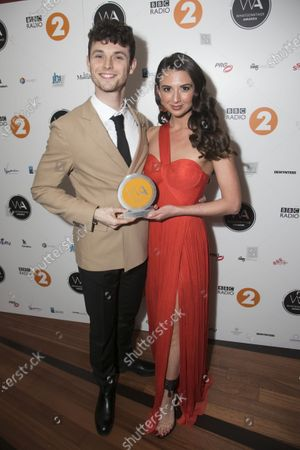 Charlie Stemp and Zizi Vaigncourt-Strallen accept the award for Best Musical Revival