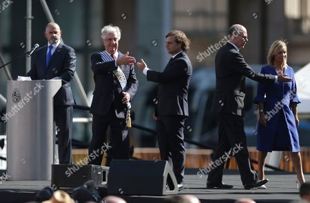 Stock Image of Luis Lacalle Pou, Tabare Vazquez. Uruguay's new President Luis Lacalle Pou, center, and outgoing president Tabare Vazquez, second from left, point at each other before Lacalle Pou took the oath of office in Montevideo, Uruguay