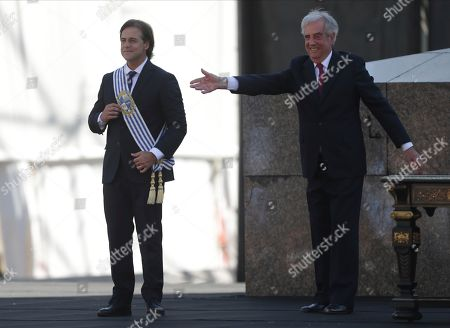 Luis Lacalle, Tabare Vazquez. Uruguay's new President Luis Lacalle Pou smiles after receiving the presidential sash from outgoing president Tabare Vazquez in Montevideo, Uruguay