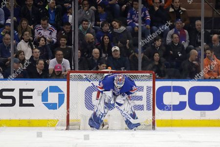 New York Rangers goaltender Henrik Lundqvist reacts after being scored on during the second period of the NHL hockey game against the Philadelphia Flyers, in New York