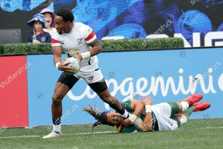 Stock Image of United States' Carlin Isles, left, is tackled by South Africa's Selvyn Davids during the Los Angels Sevens rugby tournament, in Carson, Calif
