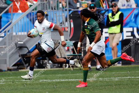 United States' Carlin Isles, left, runs with the ball away from South Africa's Cecil Afrika during the Los Angels Sevens rugby tournament, in Carson, Calif