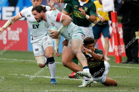Stock Photo of United States' Perry Baker, left, is tackled by South Africa's Kurt-Lee Arendse during the Los Angels Sevens rugby tournament, in Carson, Calif