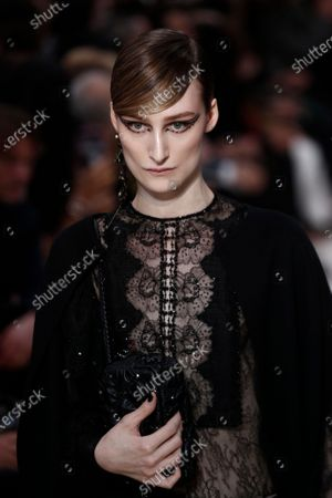 Stock Picture of A model presents a creation from the Fall/Winter 2020/21 women's collection by Italian designer Pier Paolo Piccioli for the Valentino fashion house during the Paris Fashion Week, in Paris, France, 01 March 2020. The Fall-Winter 2020/21 women's collection runs from 24 February to 03 March 2020.