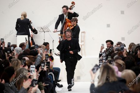 Italian designer Pier Paolo Piccioli (C) acknowledges the audience after presenting his Fall/Winter 2020/21 women's collection for the Valentino fashion house during the Paris Fashion Week, in Paris, France, 01 March 2020. The Fall-Winter 2020/21 women's collection runs from 24 February to 03 March 2020.
