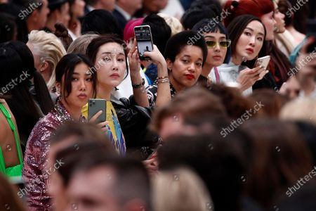 Spectators attend the presentation from the Fall/Winter 2020/21 women's collection by Italian designer Pier Paolo Piccioli for the Valentino fashion house during the Paris Fashion Week, in Paris, France, 01 March 2020. The Fall-Winter 2020/21 women's collection runs from 24 February to 03 March 2020.