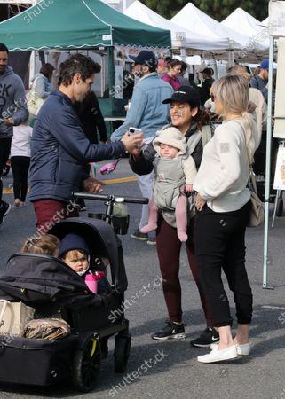 Ali Fedotowsky, husband Kevin Mann and their son Riley