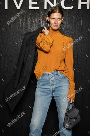 Malgosia Bela poses for photographers ahead of the Givenchy fashion collection during Women's fashion week Fall/Winter 2020/21 presented in Paris