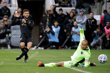 Los Angeles FC's Diego Rossi, left, shoots past Inter Miami CF goalkeeper Luis Robles during the second half of an MLS soccer match, in Los Angeles