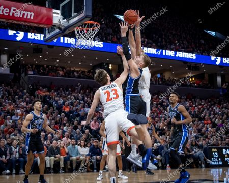 Duke Forward Jack White (41) is blocked by Virginia Forward Jay Huff (30) during the NCAA Basketball game between the Duke University Blue Devils and University of Virginia Cavaliers at John Paul Jones Arena in Charlottesville, VA