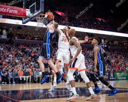 Virginia Forward Jay Huff (30) blocks Duke Forward Jack White (41) during the NCAA Basketball game between the Duke University Blue Devils and University of Virginia Cavaliers at John Paul Jones Arena in Charlottesville, VA