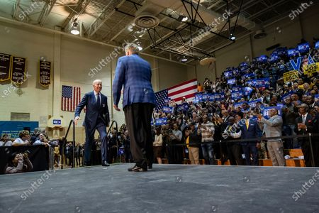 Former Virginia Governor Terry McAuliffe (C, right) US Democratic presidential candidate Joe Biden (C, left) during a campaign rally at Booker T. Washington High School in Norfolk, VA, USA, 1 March 2020. Biden is coming off of a major win in the South Carolina Democratic Primary and is hoping to keep the momentum going in Virginia on Super Tuesday where voters will cast their ballots with 13 other states.