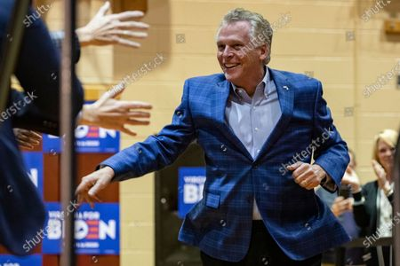 Former Virginia Governor Terry McAuliffe greets supporters of US Democratic presidential candidate Joe Biden during a campaign rally at Booker T. Washington High School in Norfolk, VA, USA, 1 March 2020. Biden is coming off of a major win in the South Carolina Democratic Primary and is hoping to keep the momentum going in Virginia on Super Tuesday where voters will cast their ballots with 13 other states.