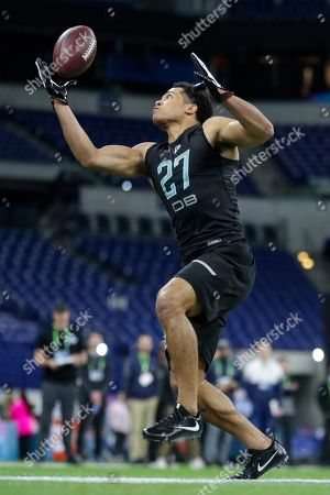 Penn State defensive back John Reid runs a drill at the NFL football scouting combine in Indianapolis