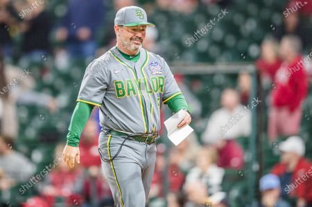 Baylor Bears head coach Steve Rodriguez walks to the dugout during the Shriners Hospitals for Children College Classic baseball game between the Baylor Bears and the Arkansas Razorbacks at Minute Maid Park in Houston, Texas. Baylor defeated Arkansas 3-2. Prentice C